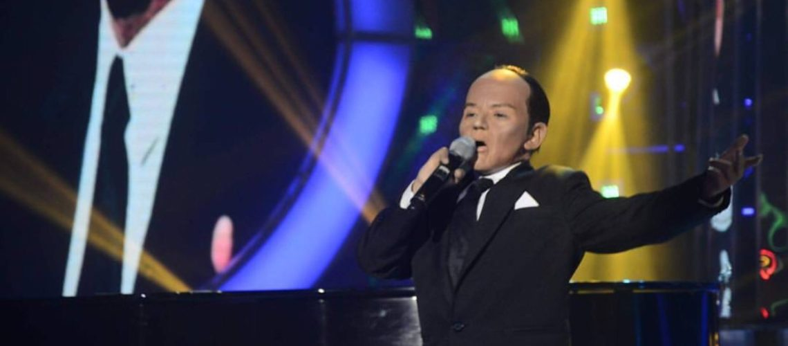 Justin Alva as Paul Anka in Your Face Sounds Familiar Kids